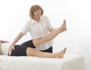 Kinesiologist treating leg
